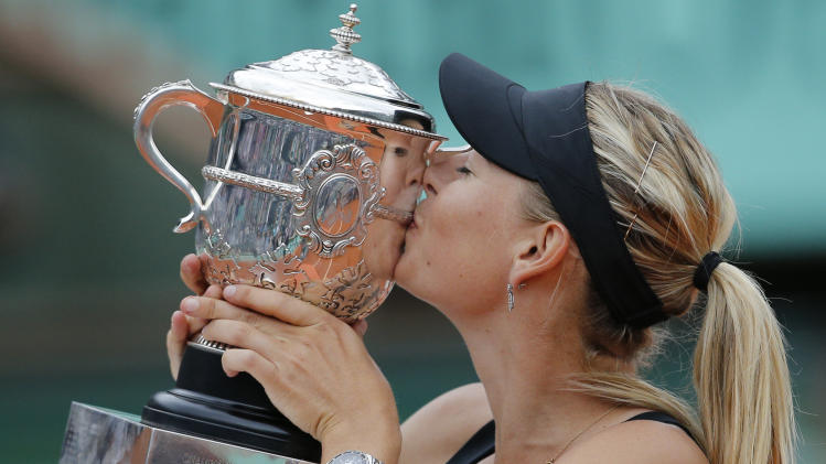 Maria Sharapova of Russia kisses the trophy after winning the women's final match against Sara Errani of Italy at the French Open tennis tournament in Roland Garros stadium in Paris, Saturday June 9, 2012. Sharapova won in two sets 6-3, 6-2. (AP Photo/Christophe Ena)