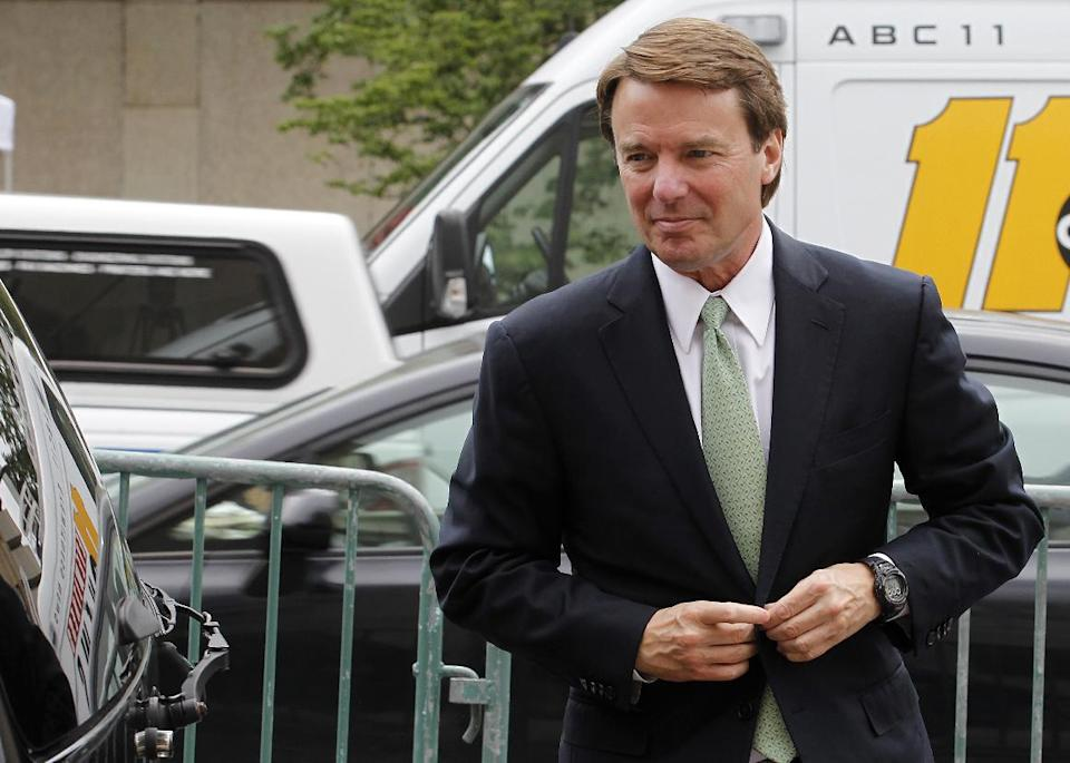 John Edwards arrives at a federal courthouse following his lunch break as the jury deliberates for a fourth day in his trial on charges of campaign corruption in Greensboro, N.C., Wednesday, May 23, 2012.  Edwards faces 30 years in prison after pleading not guilty to six campaign finance corruption charges.(AP Photo/Bob Leverone)