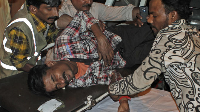 A Pakistani man, who was injured in a bomb blast, is brought to a hospital in Karachi, Pakistan, Sunday, March 3, 2013. Pakistani officials say a bomb blast has killed dozens of people in a neighborhood dominated by Shiite Muslims in the southern city of Karachi. (AP Photo/Shakil Adil)