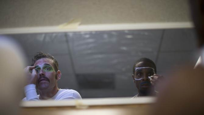 """Inmates Dillon and Manson apply make-up on their faces before the workshop """"Commedia Dell'Arte"""", part of the The Actors' Gang Prison Project program at the California Rehabilitation Center in Norco, California"""