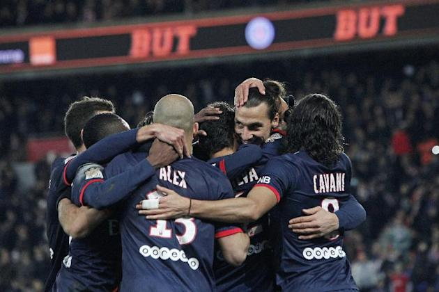 Paris Saint Germain's forward Zlatan Ibrahimovic from Sweden, second from right, celebrates with teammates after Paris Saint Germain's Thiago Silva scored, during their French League one socce