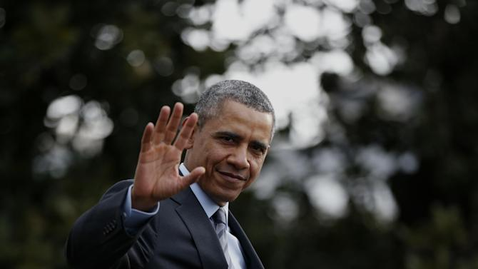 President Barack Obama waves to reporters as he walks on the South Lawn of the White House in Washington, Wednesday, Feb. 19, 2014, before boarding the Marine One helicopter to Andrews Air Force Base, Md., for his trip to Mexico. (AP Photo/Charles Dharapak)