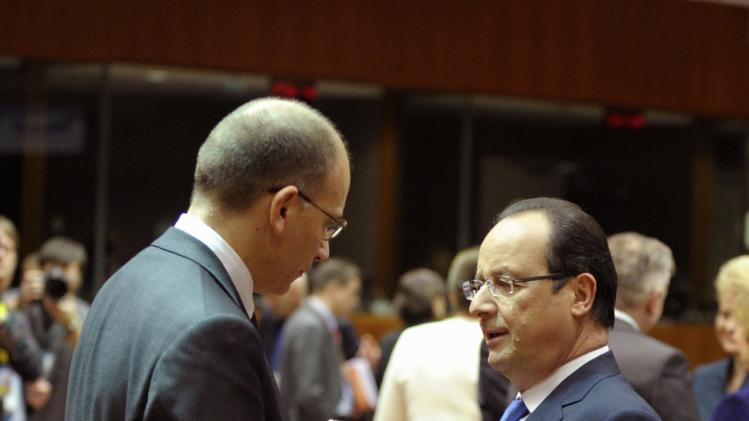 France's President Hollande talks to Italy's PM Letta during a EU leaders summit in Brussels