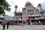 <p>Vendors sell Muslim food during the month of Ramadan in front of the Sultan mosque in Singapore. Singapore's 2010 GDP per capita stood at $56,532, while Hong Kong ($45,301) -- the only other Asian economy in the top 10 that year -- was in fourth place.</p>