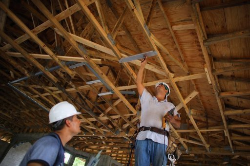 <p>Construction workers work on building a home in Boca Raton, Florida, in September 2012. US home construction rose again in October following September's strong surge, the Commerce Department said Tuesday in a further sign of recovery in the housing market.</p>