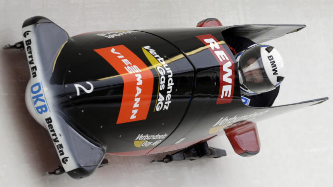 Germany pilot Maximilian Arndt and brakeman Marko Huebenbecker make a run in the two-man bobsled World Cup competition, Friday, Nov. 9, 2012, in Lake Placid, N.Y. They finished in ninth place. (AP Photo/Mike Groll)