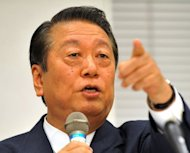 Veteran Japanese powerbroker Ichiro Ozawa (pictured in 2011) and 51 of his followers said on Monday they will leave the country's ruling party over a sales tax hike. The 52 lawmakers -- 40 from the lower house and 12 from the upper chamber of parliament -- submitted their resignations to Prime Minister Yoshihiko Noda's Democratic Party of Japan