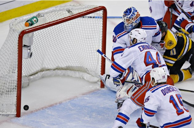 New York Rangers goalie Lundqvist watches the goal scored by the Boston Bruins with his teammates during Game 5 of their NHL Eastern Conference semi final hockey playoff game in Boston