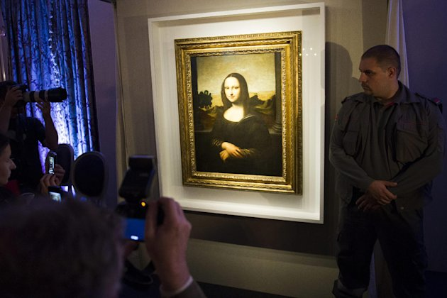 A painting attributed to Leonardo da Vinci representing Mona Lisa, is displayed during a presentation in Geneva, Switzerland, Thursday, Sept.27, 2012. The Mona Lisa Foundation, a non-profit organizati