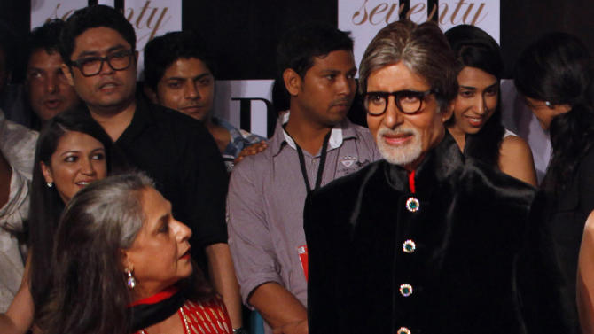 "Bollywood star Amitabh Bachchan, left, and his wife Jaya Bachchan arrive for a party on the eve of his 70th birthday in Mumbai, India, Wednesday, Oct. 10, 2012. Affectionately known as ""Big B,"" Bachchan has acted in around 180 films in a career spanning four decades in Bollywood, the home of India's prolific movie industry. (AP Photo/ Rajanish Kakade)"