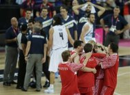 Members of Russia&#39;s basketball team celebrate after defeating Argentina, 81-77, in the men&#39;s bronze medal basketball game at the 2012 Summer Olympics, Sunday, Aug. 12, 2012, in London. (AP Photo/Morry Gash)
