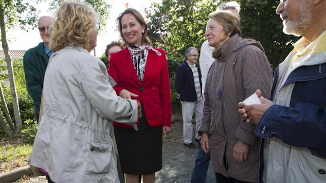 French former Socialist presidential candidate Segolene Royal, center, campaigns in La Rochelle, western France, Saturday, June 16, 2012. Royal is facing a Socialist Party opponent in the second round election next Sunday. (AP Photo/Yohan Bonnet)