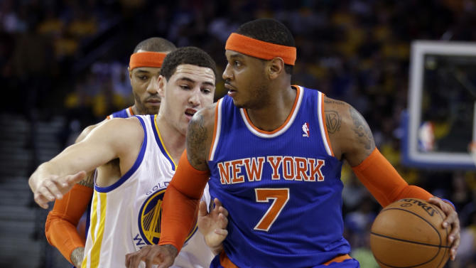 New York Knicks' Carmelo Anthony (7) drives the ball against Golden State Warriors' Klay Thompson during the first half of an NBA basketball game Monday, March 11, 2013, in Oakland, Calif. (AP Photo/Ben Margot)