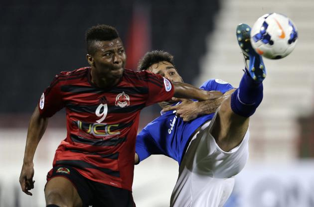 Uche of Al-Rayyan fights for the ball with Zadeh of Esteghlal during their AFC Championship League soccer match in Doha