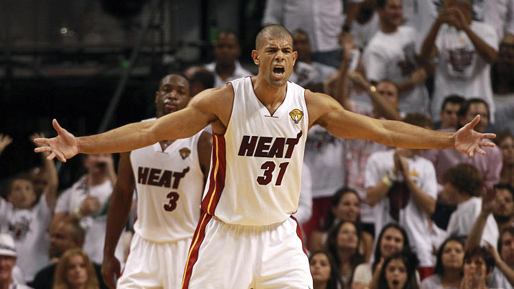 Miami Heat's Shane Battier yells as he prepares to defend against the Oklahoma City Thunder during the second quarter of Game 3 of the NBA Finals basketball series, Sunday, June 17, 2012, in Miami. (AP Photo/The Miami Herald, Charles Trainor Jr.)  MAGS OUT