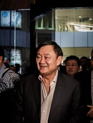Former Thai PM Thaksin Shinawatra, pictured here in July, now lives in self-imposed exile overseas to avoid a jail term imposed in his absence for corruption, but his younger sister Yingluck Shinawatra is the current prime minister