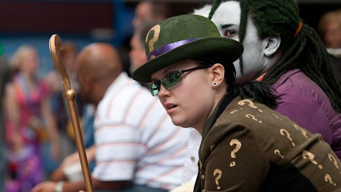 Christina Barton, of Douglasville, Ga., watches fellow attendees walk along the sidewalk at Dragon Con in Atlanta, on Friday, Aug. 31, 2012. The annual science fiction and fantasy convention drew big crowds and had more than 30,000 pre-registered attendees. (AP Photo/Ron Harris)