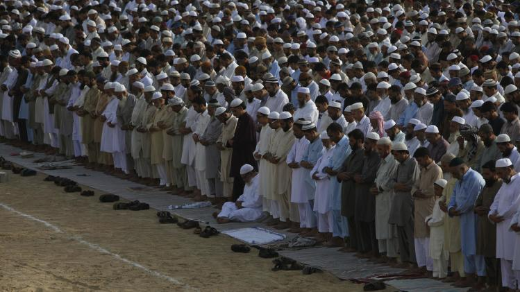 Pakistani Muslims offer Eid al-Fitr prayers at Karachi's railway grounds