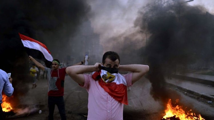 An Egyptian protestor covers his face during clashes in Cairo, on August 30, 2013