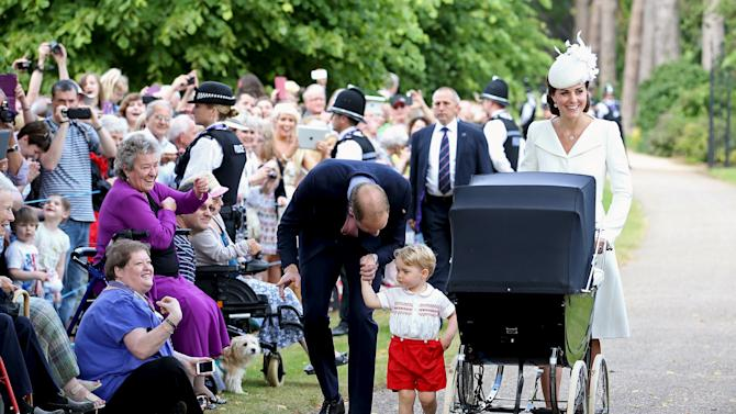 Britain's Prince William, Prince George, Catherine, Duchess of Cambridge, and Princess Charlotte after the christening of Princess Charlotte at the Church of St Mary Magdalene on the Sandringham Estate in King's Lynn