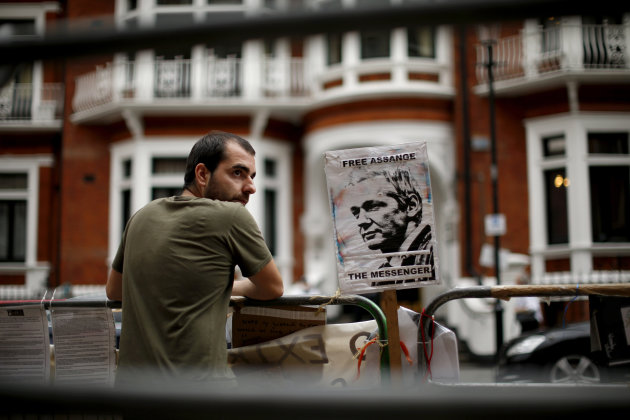 "A supporter of WikiLeaks founder Julian Assange maintains a presence outside the Ecuador embassy in London, as he continues his refuge there, Monday, Aug. 20, 2012. Wikileaks founder Julian Assange portrayed himself Sunday as a victim of an American ""witch hunt"" over his secret-spilling website in a defiant address from the balcony of the embassy where he is holed up to avoid extradition to face sex assault allegations. Surrounded by British police who want to detain him, Assange made no mention of the sex assault case in Sweden or how long he would remain in Ecuador's embassy in London, where he took refuge two months ago."