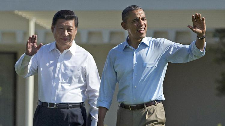 "President Barack Obama and Chinese President Xi Jinping, left, walk at the Annenberg Retreat of the Sunnylands estate Saturday, June 8, 2013, in Rancho Mirage, Calif. While saying it is critical that the U.S. and China reach a ""firm understanding"" on cyber issues, Obama told reporters his meetings with Xi have been ""terrific."" (AP Photo/Evan Vucci)"