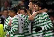 Celtic's striker Kris Commons celebrates with teammates after scoring in Glasgow on December 6, 2012. Commons and Anthony Stokes grabbed a pair apiece as Celtic came from behind to cruise to a 6-2 win over Dundee United at Parkhead on Saturday
