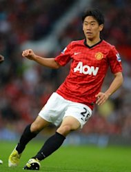 Manchester United's Shinji Kagawa, pictured in action at Old Trafford last month, was a late withdrawal from Japan's team to play Iraq on Tuesday, citing back pain