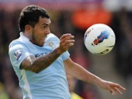 Manchester City's Carlos Tevez during a Premier League match on April 14. Tevez was quoted as saying on Monday he would like to stay at City but Roberto Mancini has insisted any contract negotiations can wait until after the end of the season