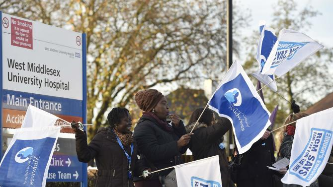 NHS workers stand on a picket line outside West Middlesex Hospital in Hounslow, west London