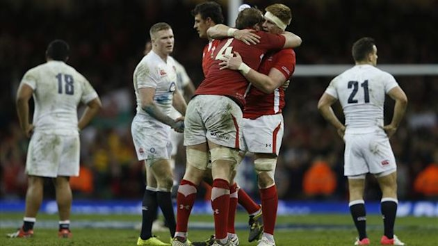 Wales' players celebrate defeating England in their Six Nations international rugby union match at the Millennium Stadium in Cardiff