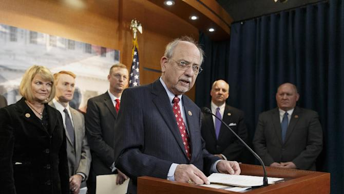 """Rep. Norman """"Doc"""" Hastings, R-Wash., center, discusses a new report that proposes alterations to the 40-year-old Endangered Species Act, Tuesday, Feb. 4, 2014, during a news conference on Capitol in Washington. Hastings, along with Rep. Cynthia Lummis, R-Wyo., left, led the Endangered Species Act Congressional Working Group, a panel of House Republicans who want the law to be administered by the states to balance wildlife protection with economic development. (AP Photo/J. Scott Applewhite)"""
