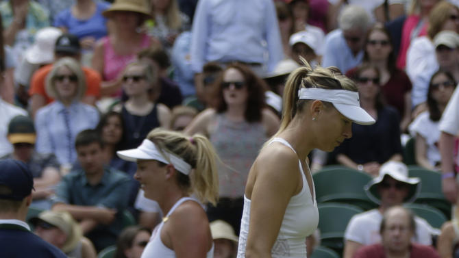Maria Sharapova of Russia, right, and Coco Vandeweghe of the United States change ends , during their singles match at the All England Lawn Tennis Championships in Wimbledon, London, Tuesday July 7, 2015. (AP Photo/Pavel Golovkin)