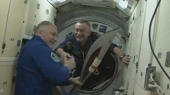 Astronauts Improvise Olympic Torch Relay On Space Station