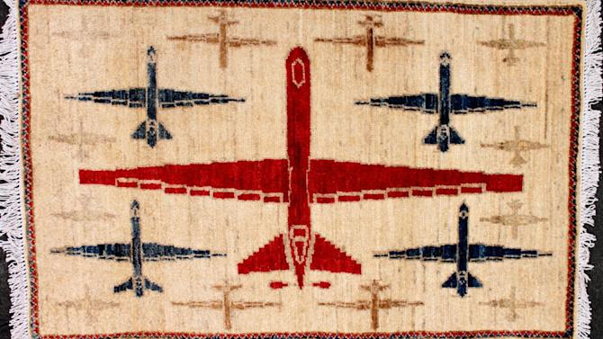 In the 1980s, as mujahideen guerillas fought the Soviets, weavers embraced patterns with planes, tanks, rifles and grenades on them. Today, rugs hand-woven in Pakistan feature drones.