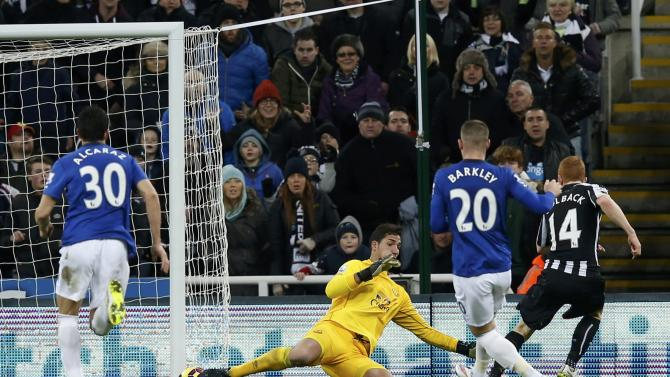 Newcastle United's Jack Colback shoots to score a goal against Everton during their English Premier League soccer match at St James' Park in Newcastle