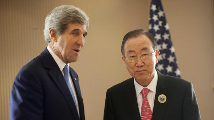 U.S. Secretary of State John Kerry, left, and UN Secretary General Ban Ki-Moon, right, shake hands as they pose for photos before the start of their meeting at Bayan Palace in Kuwait City, Kuwait,Wednesday, Jan. 15, 2014. (AP Photo/Pablo Martinez Monsivais, Pool)