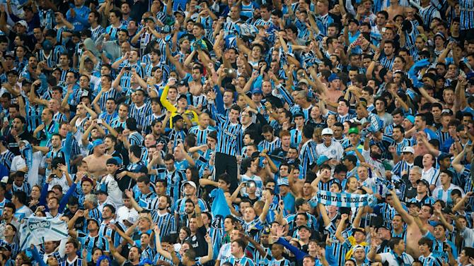 Brazil's sports tribunal throws top flight club Gremio out of the national Cup after fans racially insulted a visiting black goalkeeper