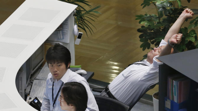 A worker stretches on a chair during a morning trading at the Tokyo Stock Exchange in Tokyo Monday, June 17, 2013. Asian stocks edged up Monday amid hopes that the U.S. Federal Reserve will put off plans to wind down its stimulus program. Tokyo's Nikkei 225, the regional heavyweight, jumped 2.2 percent to 12,960.81, extending Friday's 2.4 percent gain. (AP Photo/Koji Sasahara)