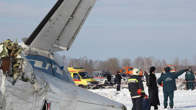 In this photo provided by Russia Emergency Situations Ministry press service, Russian emergency workers search the crash site of the ATR-72 plane crash outside Tyumen, a major regional center in Siberia, Russia, Monday, April 2, 2012.  The passenger plane crashed shortly after take-off on Monday morning, killing 31 and leaving 12 survivors hospitalised in serious condition, Russian emergency officials. The French-Italian-made twin-engine turboprop ATR-72 plane was operated by UTair, flying from Tyumen to the oil town of Surgut with 39 passengers and four crew. (AP Photo/Russian Ministry of Emergency Situations press service)