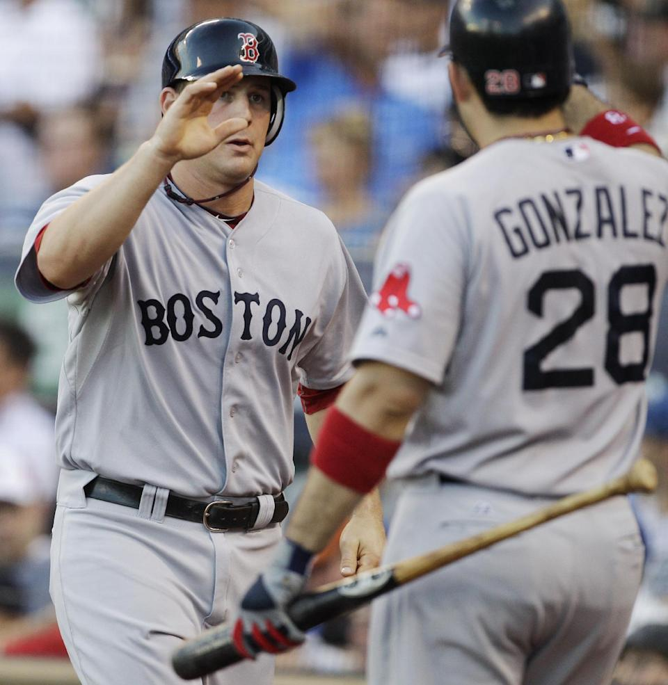 Boston Red Sox's Ryan Lavarnway, left, is congratulated by teammate Adrian Gonzalez (28) after scoring a run during the third inning of a baseball game game against the Kansas City Royals in Kansas City, Mo., Saturday, Aug. 20, 2011. (AP Photo/Orlin Wagner)