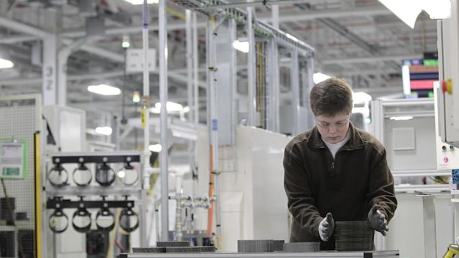 FILE - In this Thursday, Feb. 28, 2013, file  photo, Jordan Kenyon works on the assembly line during a media tour before an investment and jobs announcement event at the Chrysler transmission plant in Kokomo, Ind. Chrysler reports quarterly earnings on Monday, April 29, 2013. (AP Photo/AJ Mast)