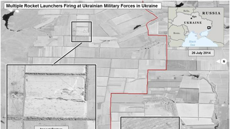 Satellite images of the Ukraine-Russia border area taken by Digital Globe appear in a graphic, produced by the Department of National Intelligence in Washington