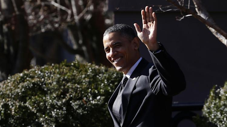 President Barack Obama waves to reporters as they shout questions to him regarding the fiscal cliff as he walks across Pennsylvania Avenue back to the White House in Washington, Thursday, Dec. 13, 2012. Obama had dropped by a holiday party for the National Security Council at Blair House. (AP Photo/Charles Dharapak)