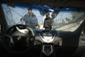 Hamas naval police inspect parts of a car which they said was seized from two Palestinians who tried to smuggle it from Egypt by sea into Gaza City