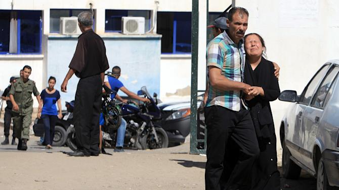 A relative of a victim, right, cries outside the hospital of Kasserine, near the Algerian border, Thursday, July 17, 2014. Militants in western Tunisia staged two simultaneous attacks on army posts while soldiers held a Ramadan feast, killing at least 14 soldiers, authorities said Thursday. (AP Photo/ Mouldi Kraeim)