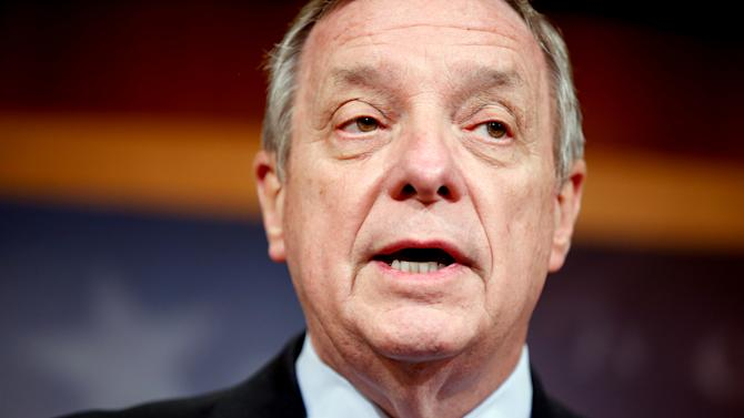 """In this March 25, 2015, photo, Senate Minority Whip Richard Durbin of Ill., speaks during a news conference on Capitol Hill in Washington, to discuss the budget. The Senate is up after House Republicans pushed through a boldly conservative budget eliminating deficits over the next decade by cutting deeply into Medicaid, food stamps and welfare, and repealing the president's health care law. """"It really is a budget that is insensitive and unaware of the reality of life for working families, and that is sad,"""" said Durbin. (AP Photo/Andrew Harnik)"""