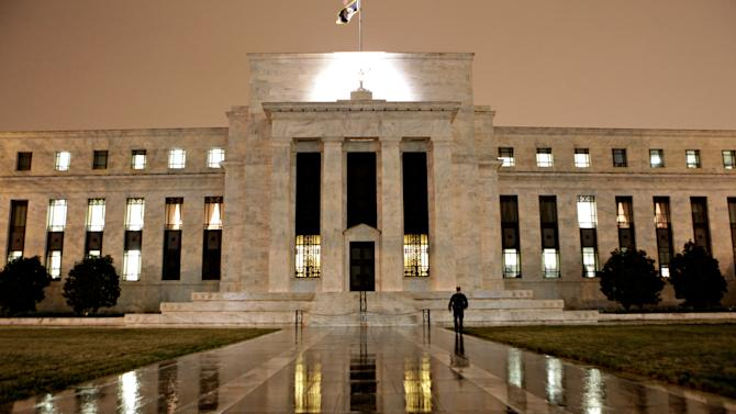 US futures head higher as Fed gathers