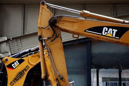 Caterpillar sees little change into 2017, cuts sales outlook