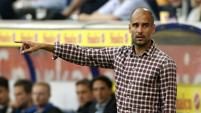 FC Bayern Munich's coach Josep Guardiola gestures during a test football match of German Bundesliga first divison Bayern Munich vs MSV Duisburg on July 21, 2014 in Duisburg